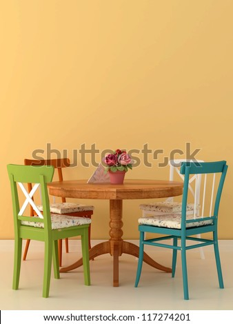 The cozy arrangement in the style of Provence with four different chairs around a wooden table on a background of bright orange wall - stock photo
