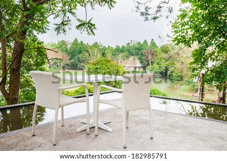 The cozy style furniture with green garden background