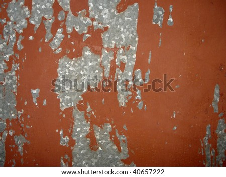 the cracked paint on an old metallic surface