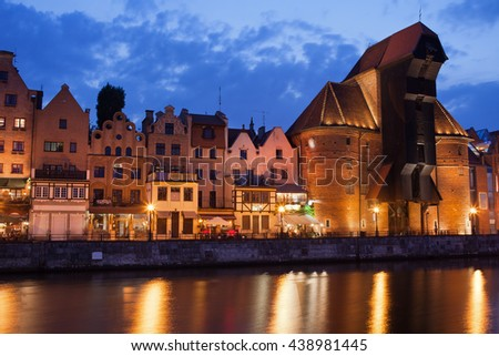 The Crane and houses in Old Town of Gdansk in Poland at dusk, city landmark at Motlawa River - stock photo