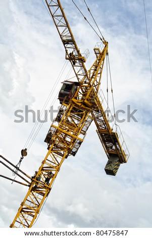 the crane load over blue sky - stock photo
