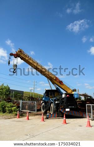 The crane truck in warehouse - stock photo