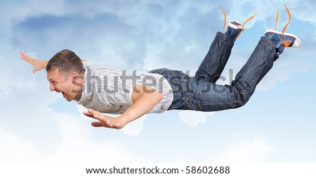 The crazy flying man in clouds - stock photo