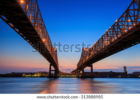 The Crescent City Connection Bridge on the Mississippi river in New Orleans Louisiana - stock photo