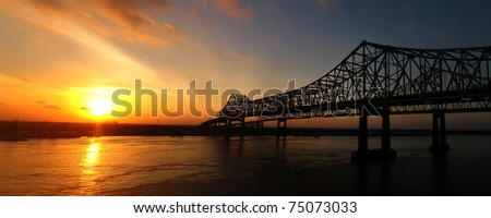 The Crescent City Connection (formerly the Greater New Orleans Bridge) at sunrise in New Orleans, Louisiana on April 11, 2011. - stock photo