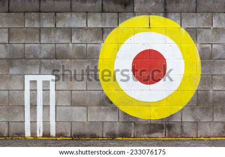 The cricket wickets and target painted on concrete wall, objective for practicing. - stock photo