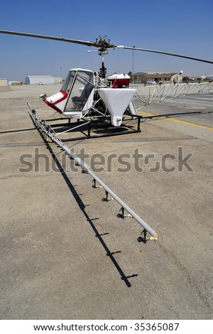 The crop duster is replaced with this small helicopter outfitted with liquid hoppers and spray nozzles - stock photo