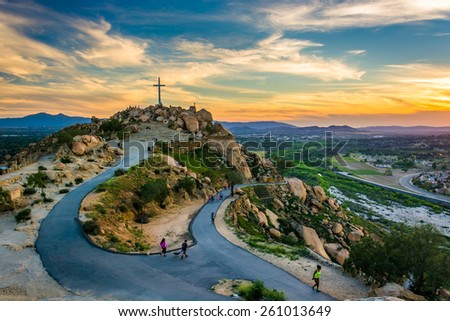 The cross and trails at sunset, at Mount Rubidoux Park, in Riverside, California. - stock photo