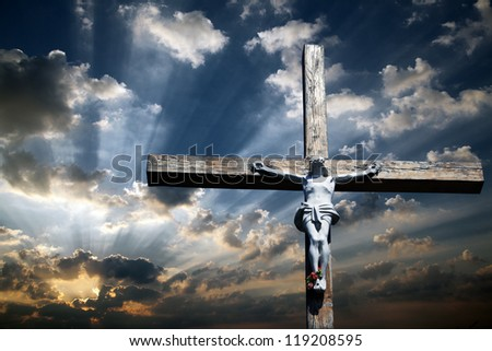 The cross of Jesus Christ against the beautiful sky - stock photo