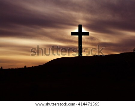 The Cross of Jesus Christ and beautiful clouds