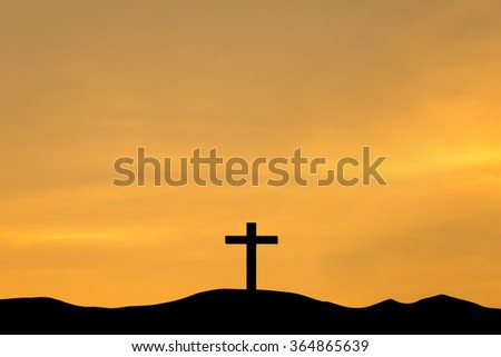 The cross on top a mountain at sunset