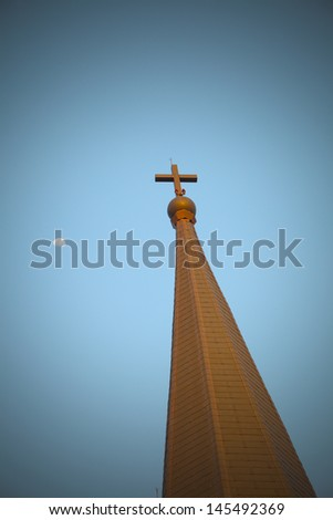 The cross on top of a blue background - stock photo