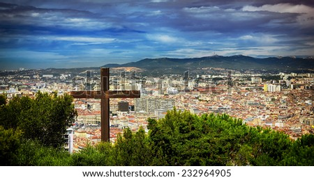 "The Cross over Marseilles.View from the historic cathedral ""Notre Dame de la Garde"" of Marseilles in South France. - stock photo"