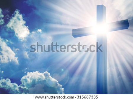 The Cross with bright sun and clouds in the background - stock photo