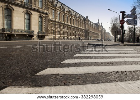 The crosswalk on the old street of Paris.