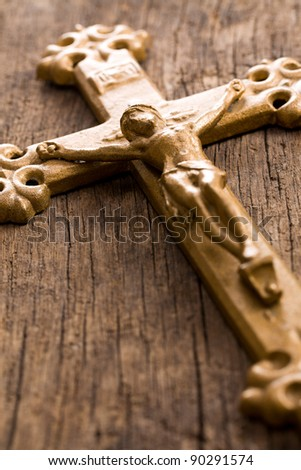 the crucifix on wooden background - stock photo
