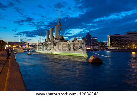 The cruiser Aurora - a symbol of the October Revolution of 1917 in Russia, moored at the Petrograd embankment in St. Petersburg. Shooting in the white nights - stock photo