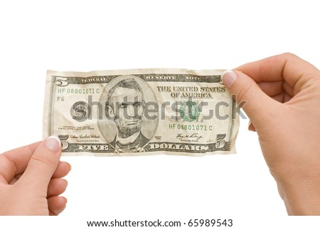 The crumpled banknote in a hand - stock photo