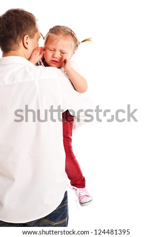 the crying baby in the arms of his father - stock photo
