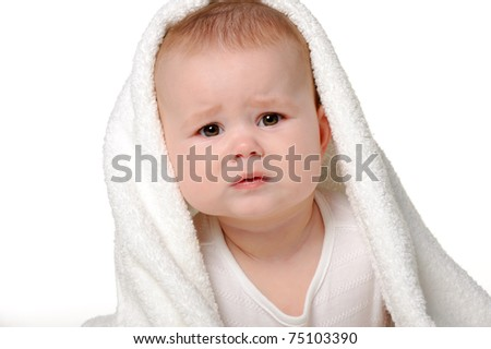 The crying baby under a towel. Age of 8 months. It is isolated on a white background - stock photo