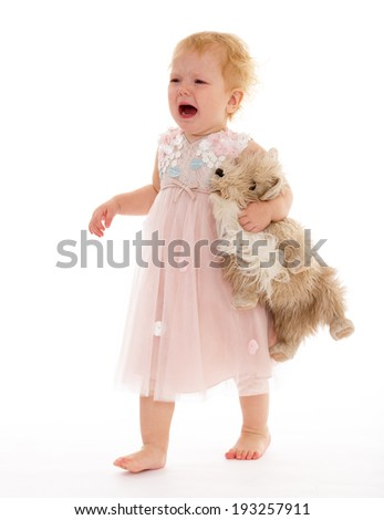 The crying girl with toy dog - stock photo