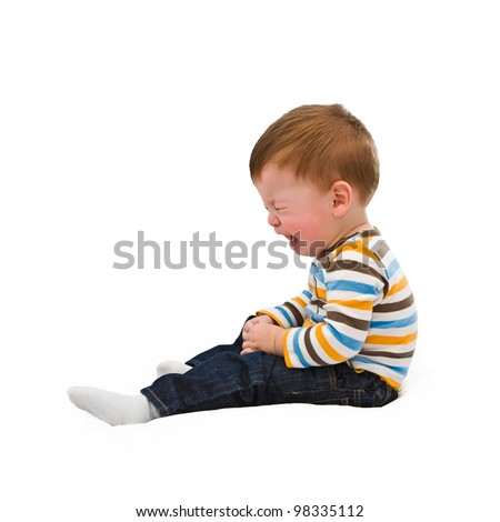The crying one-year-old child on a white background - stock photo