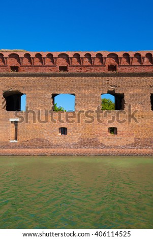 The crystal clear waters of the Gulf of Mexico surround Civil War Historic Fort Jefferson in the Dry Tortugas makes a great place for swimming and snorkeling - stock photo