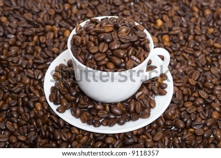 The cup full of coffee beans 3