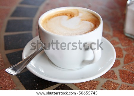 The cup of coffee in the summer restaurant