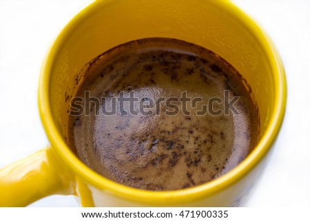 The cup of hot coffee closely. The cup of coffee on the white background. The one isolated cup of coffee.