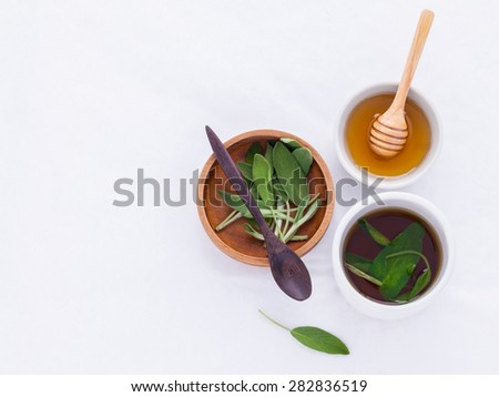 The cup of  sage healthy drinking tea for warm when illness and cold. - stock photo