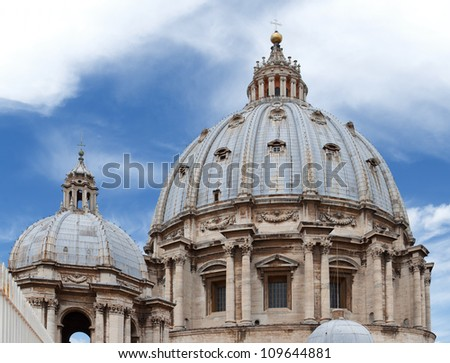 The cupola of the Basilica of Saint Peter against blue sky - stock photo