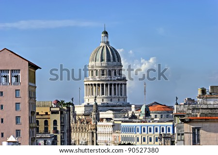 """The cupola of the """"El Capitolio"""", or National Capitol Building in Havana, Cuba, former the seat of government and today the home to the Cuban Academy of Sciences seen from a roof in the Prado - stock photo"""