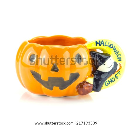 The cups are designed with a pattern of pumpkin. Decorations for Halloween - stock photo