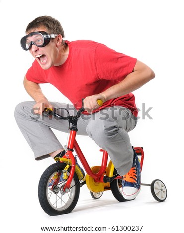 The curious man in goggles on a children's bicycle (withe background) - stock photo