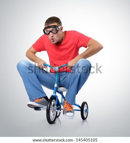 The curious man on a children's bicycle - stock photo