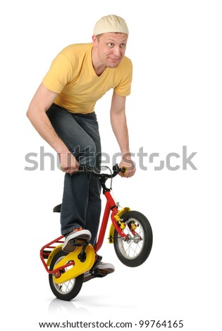 The curious man on the children's bicycle, concept biking freestyle - stock photo