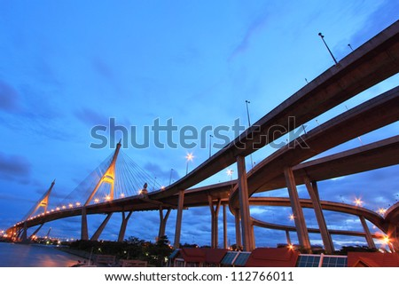The curve of suspension bridge in twilight at Bangkok,Thailand - stock photo