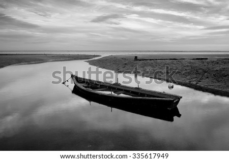 the curve of the river , boat in the Ria Formosa, Olhão, Algarve, Portugal