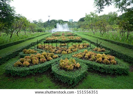 The curve road in a public park lead to the fountain. - stock photo