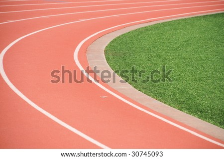 the curve to a runners track showing the inside lane - stock photo