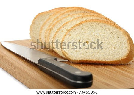 The cut bread on a chopping board with a knife. It is isolated on a white background - stock photo