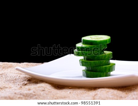 the cut cucumber on a plate