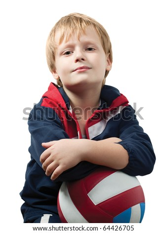 The cute little boy in a jumpsuit holds a volleyball ball and smiles. Isolated over white background.
