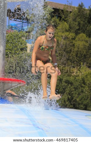 The cute little girl in the water park
