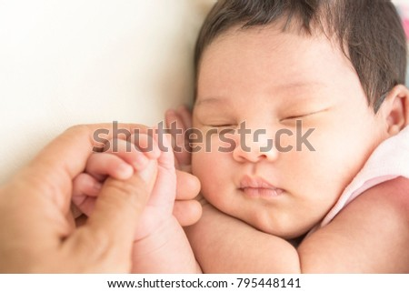 The cute newborn in a bright room. two week old