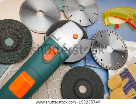 The cutting machine and various detachable disks  - stock photo