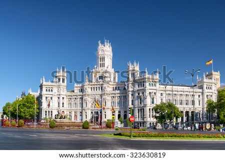 The Cybele Palace (Palacio de Cibeles) or the Palace of Communication on the Cybeles Square (Plaza de Cibeles) in Madrid, Spain. Madrid is a popular tourist destination of Europe. - stock photo