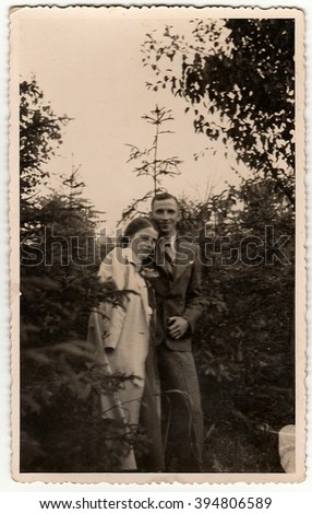 THE CZECHOSLOVAK  REPUBLIC - CIRCA 1940s: Vintage photo shows woman and man pose in the forrest. Black & white antique photography.