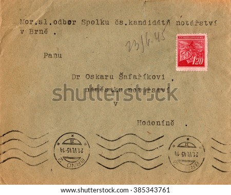 THE CZECHOSLOVAK REPUBLIC - JUNE 10, 1945: A vintage used envelope and stamp. Rich stain and paper details. Can be used as background.